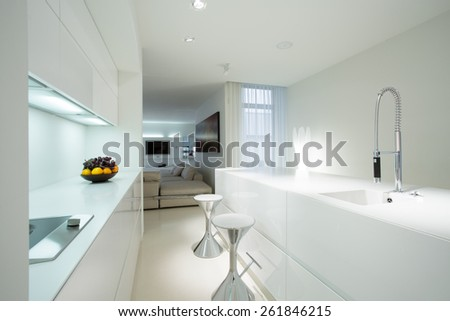 Interior of white kitchen in contemporary house - stock photo