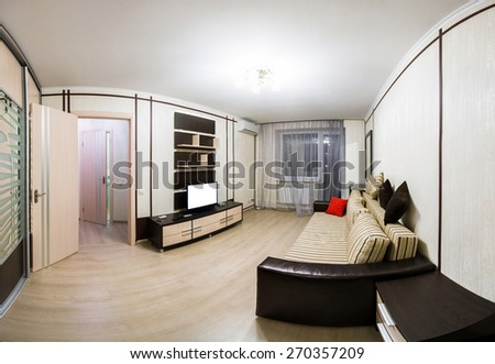 Interior room is equipped with furniture with sofa and TV - stock photo