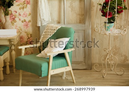 Interior room with chairs, pillows, door and flowers. Room in retro style. - stock photo