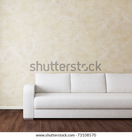 Interior room with white fabric sofa near wall - stock photo