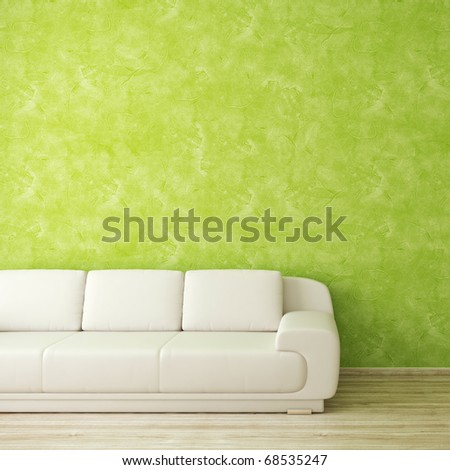 Interior scene with white sofa in front of green stucco wall - stock photo