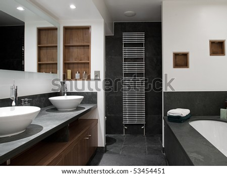 Interior Shot of a Luxury Bathroom with His and Hers Sinks - stock photo