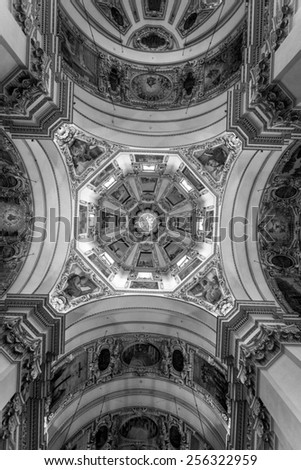Interior shot of beautiful decorated ceiling at Salzburg Cathedral - stock photo