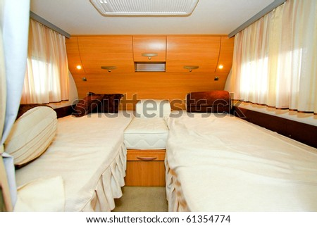 Interior shot of bedroom in recreation vehicle - stock photo