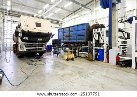 Interior shot of big truck service garage - stock photo