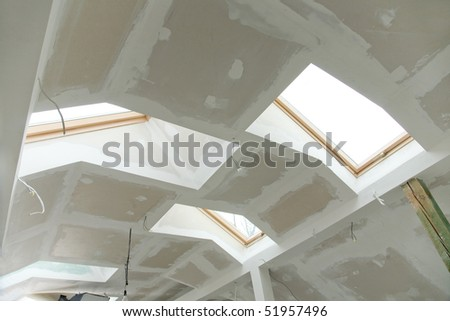 Interior shot of unfinished house attic - roof - stock photo