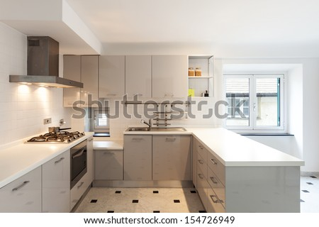 Interior, small apartment, white kitchen view - stock photo