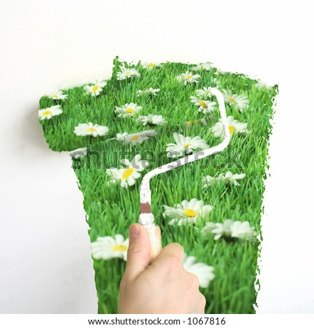 interior spring decoration : paint a wall with 'spring-green' paint - stock photo