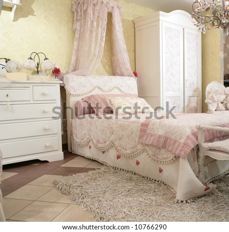 interior to luxurious baby bedroom in rococo style, expensive furniture - stock photo