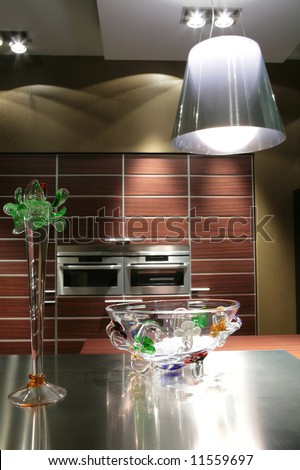interior to modern kitchen in brown tone with glass vase and lampshade - stock photo