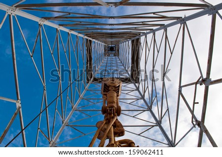 Interior upward view of an old oil rig - stock photo