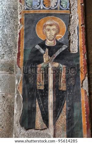 Interior view in Basilica of Saint Ambrose in Milan, Italy - fresco renovation - stock photo