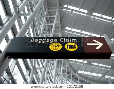Interior view looking up at Baggage Claim direction sign at Seattle (Sea-Tac) airport - stock photo