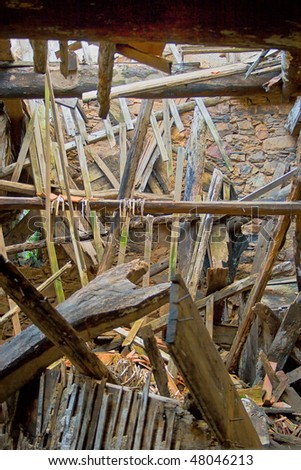 interior view of a collapsed building made of wood - stock photo
