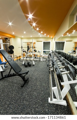 Interior view of a gym with equipment. - stock photo