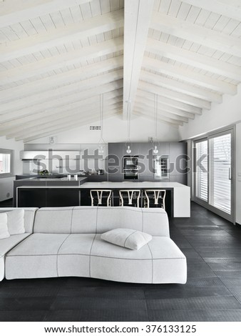 interior view of a living room with wood floor in he attic room - stock photo