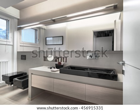 interior view of a modern bathroom in foreground the washbasin - stock photo