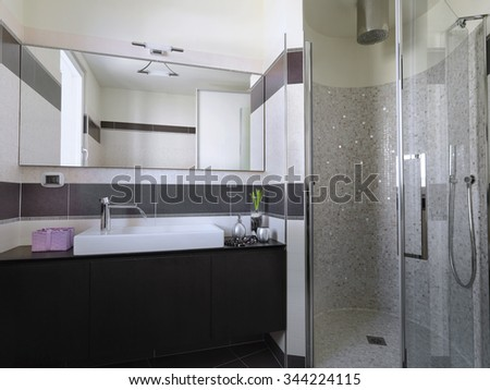 interior view of a modern bathroom in the foreground the washbasin