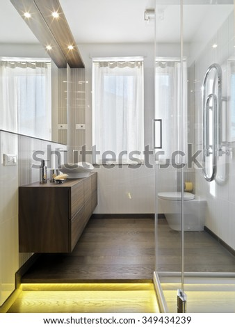 interior view of a modern bathroom with wood floor - stock photo