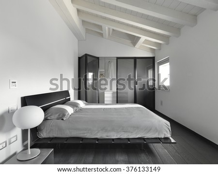 interior view of a modern bedroom  with wood floor in the attic room   - stock photo