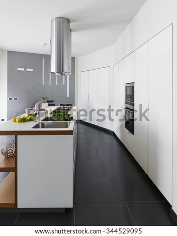 interior view of a modern kitchen with black floor - stock photo