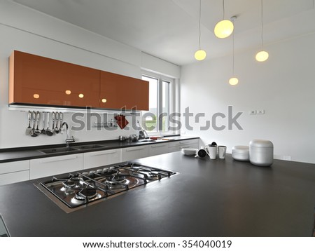 interior view of a modern kitchen with kitchen cabinet - stock photo