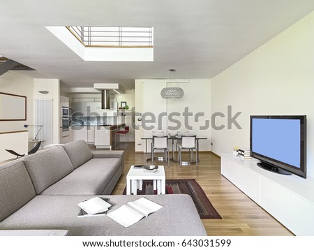 Interior View Of A Modern Living Room In The Attic With Wood Floor Overlooking On