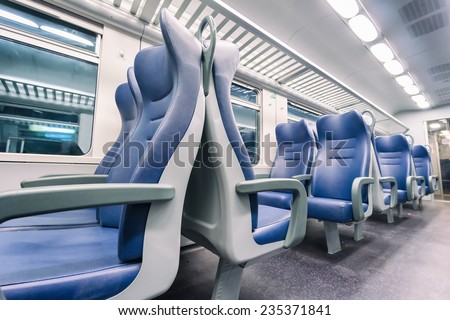 interior view of a modern train - stock photo