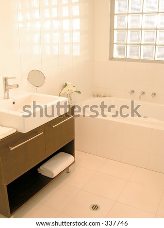 Interior view of a new bathroom - stock photo
