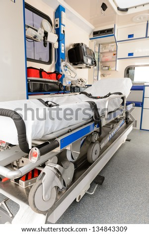 Interior view of an ambulance car with gurney in focus - stock photo