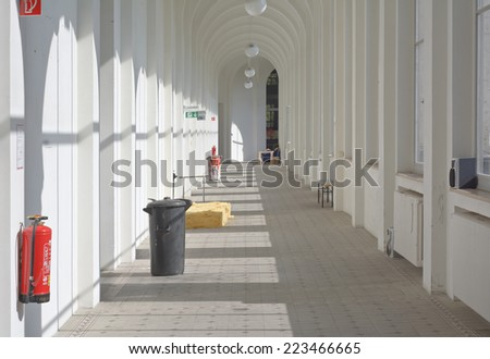 Interior View of Corridor with Trash Can and Workshops - stock photo
