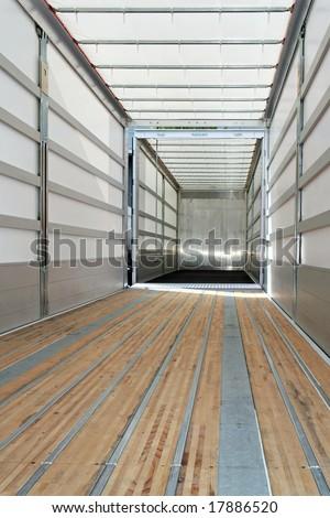 Interior view of empty semi truck trailer - stock photo