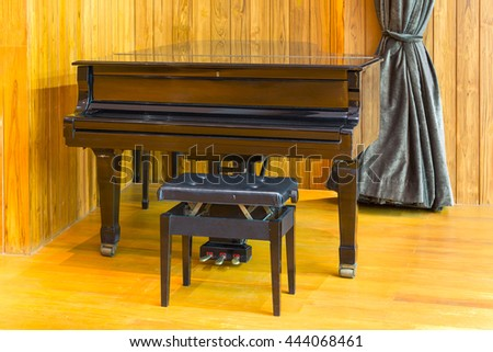 Interior view of Grand piano and bench in a empty room. - stock photo