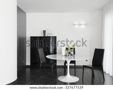interior view of modern dining room with leather chairs and round white table - stock photo