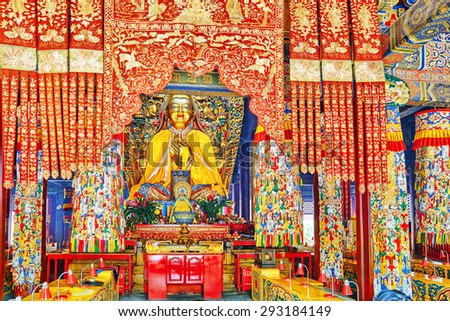Interior view of Yonghegong Lama Temple.Beijing. Lama Temple is one of the largest and most important Tibetan Buddhist monasteries in the world. - stock photo