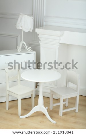 Interior white room with columns in ancient style and different furniture  - stock photo