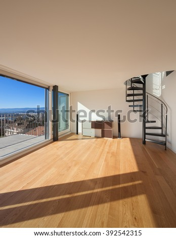 Interior, wide open space of a duplex, large window - stock photo