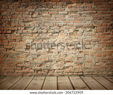 interior with an old brick wall and wooden floor - stock photo