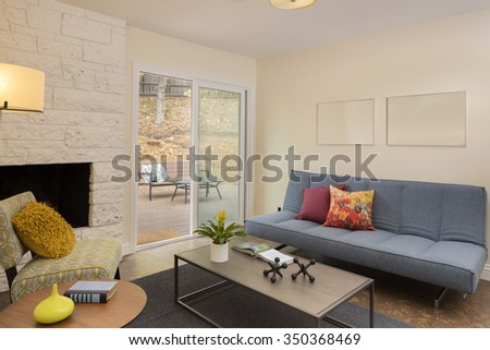Interior with couch, sliding door and fire place. - stock photo