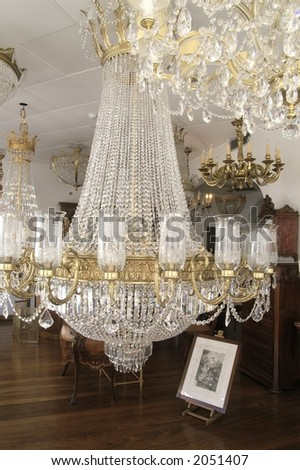 Interior with glass chandeliers - stock photo