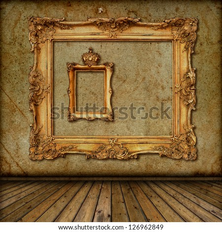 interior with golden frame on the wall. room with vintage wallpaper and wooden floor - stock photo