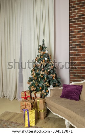 Interior with sofa, decorated christmas tree and presents