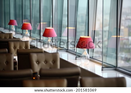 Interior with some lamps and tall windows. - stock photo