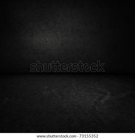 Interior with textured floor and an dark wall - stock photo