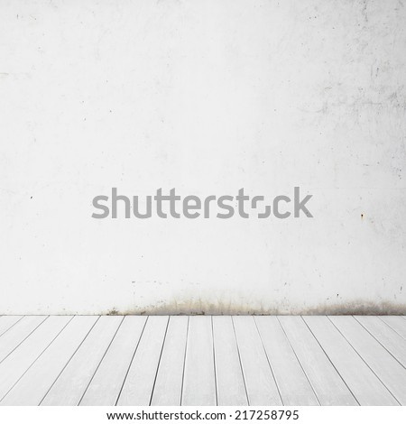 Interior with white grungy wall and wood floor - stock photo