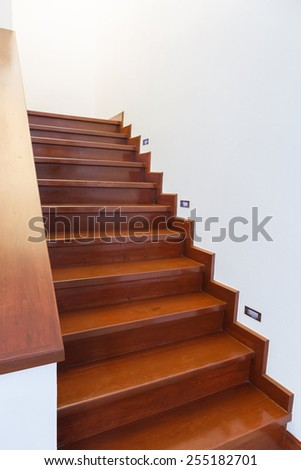 Interior wooden staircase of new house  - stock photo