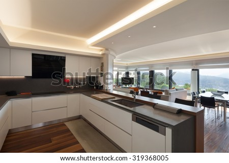 Interiors, beautiful modern kitchen of a luxury apartment - stock photo