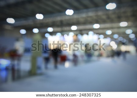 Interiors lights, generic trade show background. Intentionally blurred post production. - stock photo