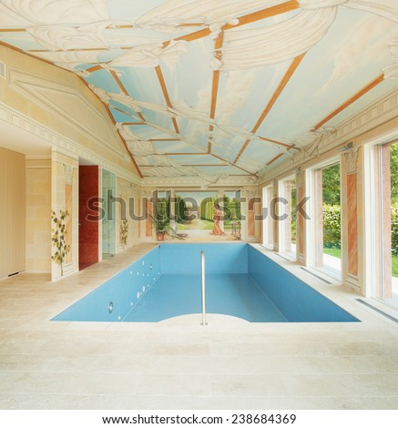 Interiors of a house with a pool painted - stock photo