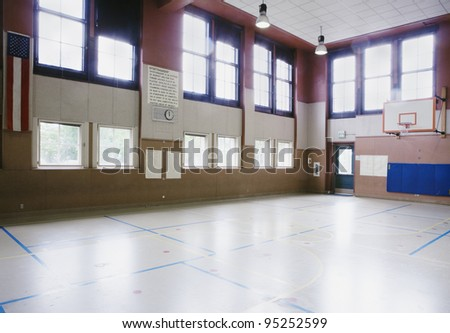 Interiors of an empty basketball court - stock photo